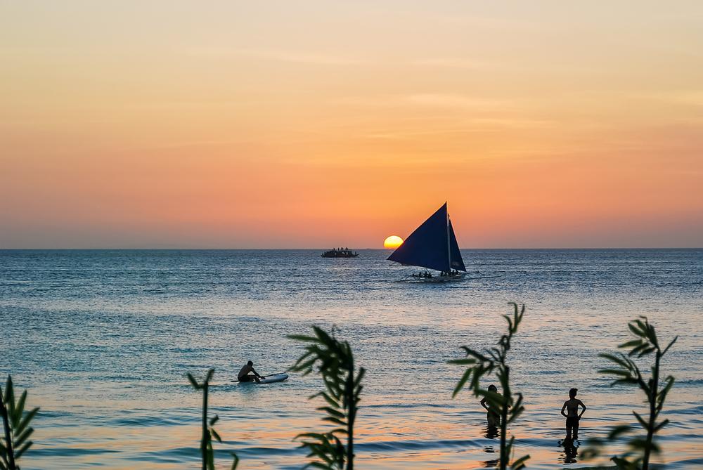 boats along the batangas horizon