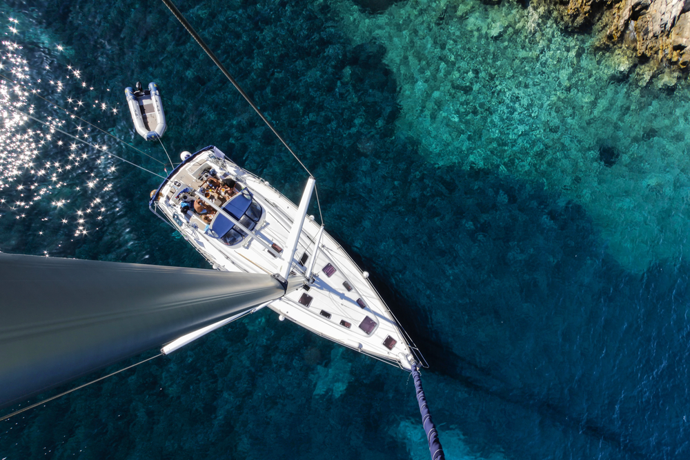 a yacht sailing along the coast