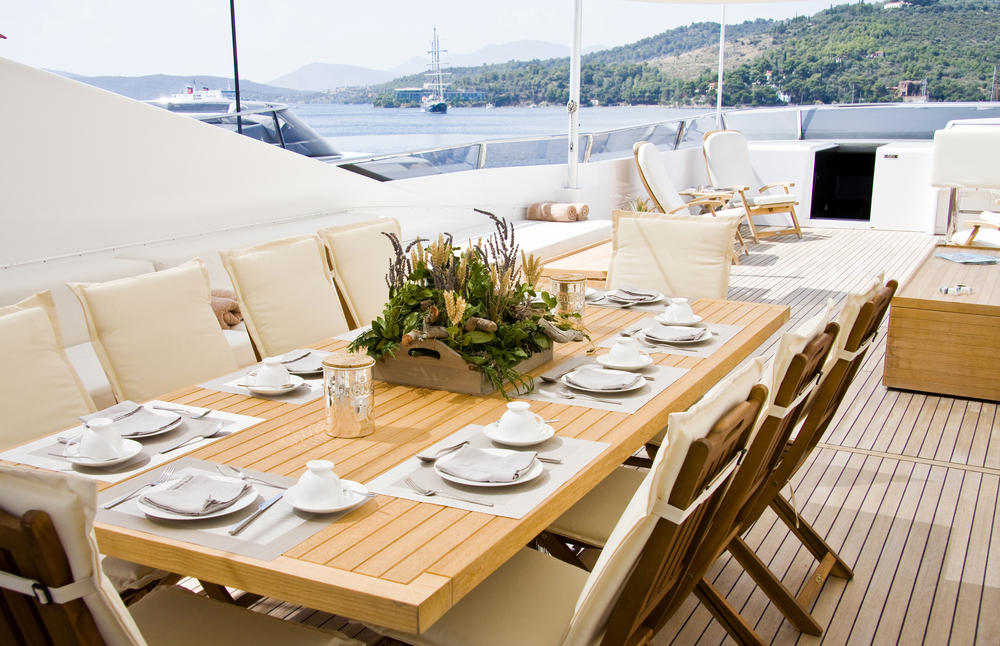 yacht table setting with wood and linen finishes