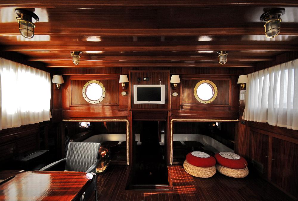 yacht with dark wood interiors